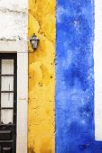 Picturesque yellow and blue wall, Obidos, Portugal