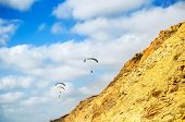 Flying Paragliders