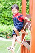 The boy climbing the net