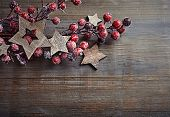 Rustic Christmas decorations on wooden surface; seen from above