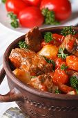Stew In Tomato Sauce With Vegetables In A Pot. Vertical