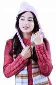 Girl With Knitted Clothes, Shawl, And Hat