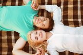 Pretty Couple In Love Lying On The Plaid Autumn