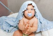Baby Boy With Soother, Covered Blue Towel