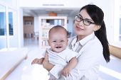 Asian Businesswoman And Her Baby 1