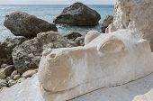 Hippo sculpture from stone on Red Beach near Matala