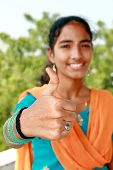 Young Indian Girl With Thumbs Up.