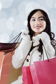 Gorgeous Teenage Girl Holding Shopping Bags