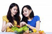 Women Making Salad Together