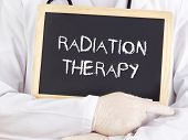 stock photo of radiation therapy  - Doctor shows information on blackboard - JPG