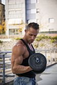 picture of hunk  - Handsome Hunk Man Lifting Weights Outdoor - JPG