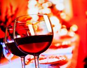 Two Red Wine Glasses Against Restaurant Table Background