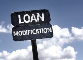 image of modification  - Loan Modification sign with clouds and sky background  - JPG