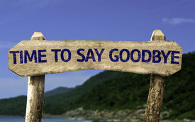 stock photo of say goodbye  - Time To Say Goodbye wooden sign with a beach on background - JPG