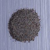 pic of opiate  - Top view of poppy seeds against purple vinyl background - JPG