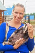 foto of badger  - Young attractive woman with badger - JPG