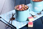 stock photo of vanilla  - Mugs of hot coffee with marshmallow on napkin with lump sugar - JPG