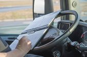 Постер, плакат: Truck Driver Is Writing In The Documentation