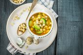 stock photo of brussels sprouts  - Homemade vegetable soup with brussels sprouts and croutons - JPG