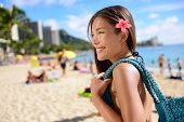 stock photo of hawaiian girl  - Asian tourist woman on vacation in Waikiki beach - JPG