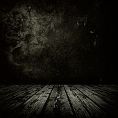 picture of wall-stone  - Dark room with stone or masonry wall and grungy old  wooden floor - JPG