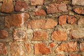 pic of cobblestone  - Brown big cobblestone wall sunny background with cement - JPG