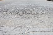 stock photo of salt mine  - sea water on dirt in salt farm will become salt after processing in the sun for several days - JPG