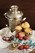 picture of bird egg  - Kulichi traditional Russian easter cakes with samovar dyed eggs and bird nest on handmade rushnik vertical - JPG