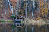 foto of backwoods  - old wooden house near the lake in forest - JPG