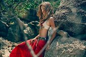 pic of traditional attire  - Tribal style girl on the stone rocks - JPG