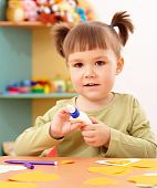 pic of arts crafts  - Cute little girl doing arts and crafts in preschool - JPG