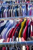 foto of flea  - Assorted second hand clothes on a flea market stall - JPG