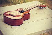 foto of ukulele  - Ukulele processed in vintage style - JPG