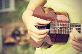 foto of ukulele  - Woman playing ukulele vintage style - JPG