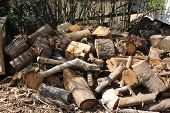 foto of wood pieces  - Firewood - pieces of wood, wood products - designed to burn in the furnace, fireplaces, furnaces or fire for heat and light.