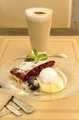 stock photo of custard  - Cherry strudel with vanilla ice - JPG