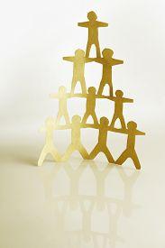 pic of human pyramid  - Human team pyramid holding hands - JPG