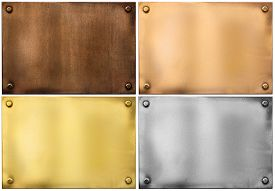 pic of four  - four various metal plates or plaques with rivets isolated on white including silver - JPG