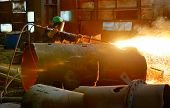 pic of torches  - worker using torch cutter inside of plant - JPG