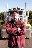 picture of truck-stop  - a stock photo of a long haul truck and a truck driver at a truck stop - JPG