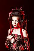 image of geisha  - Portrait of an attractive geisha with bright makeup and hairstyles for performances of kabuki - JPG