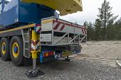 picture of boom-truck  - The support leg and a storage compartement on an industrial crane - JPG