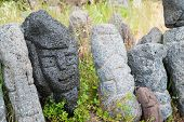 pic of stone sculpture  - Lava stone sculpture of a stylised man poured with water to make its design stand out - JPG