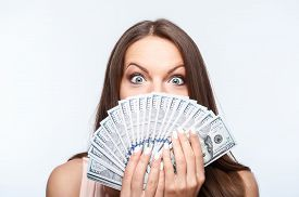 image of shock awe  - Attractive woman is holding money in her hands - JPG