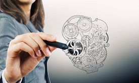 foto of mechanical drawing  - Close up of female hand drawing mechanical heart - JPG