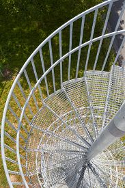 stock photo of grating  - A newel staircase from grating serves as an escape route - JPG
