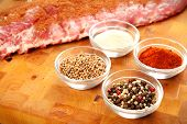 stock photo of chipotle  - Baby back rib presented with common spices used for rub seasoning