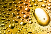 Golden close-up water drops background
