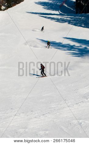 Skiers On A Wide Mountain