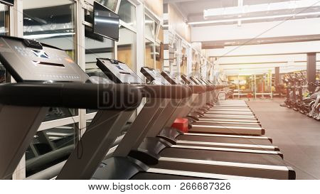 poster of Fitness Gym Club With Row Of Treadmills For Fitness Cardio Training. Healthy Lifestyle Concept. Mode